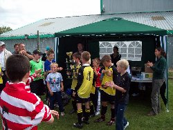 Collecting the trophy - IWCA football tournament