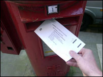 postal vote being put into letterbox
